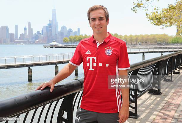 Philipp Lahm of FC Bayern Muenchen smiles in front of New York's skyline during the AUDI Summer Tour USA 2016 on August 3 2016 in Hoboken United...