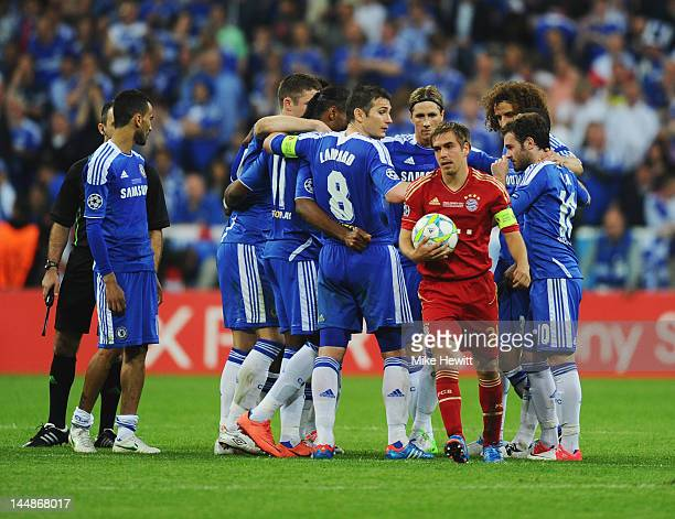 Philipp Lahm of FC Bayern Muenchen walks through the Chelsea huddle during UEFA Champions League Final between FC Bayern Muenchen and Chelsea at the...