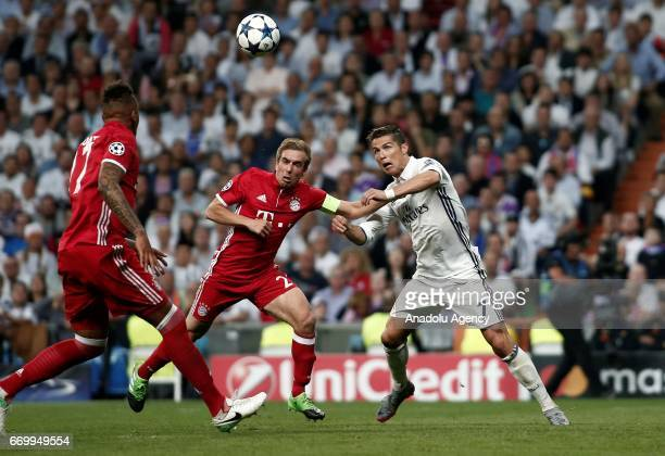 Philipp Lahm of FC Bayern Munich in action against Cristiano Ronaldo of Real Madrid during the UEFA Champions League quarter final match between FC...