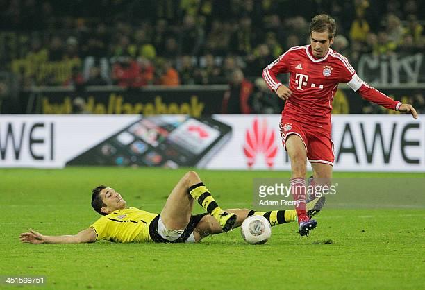 Philipp Lahm of FCBayern steals the ball from Nuri Sahin of Bor Dortmund during the Bundesliga match between FC Bayern and Bor Dortmund Signal Iduna...