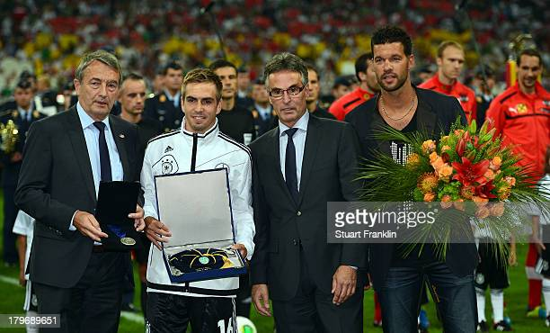 Philipp Lahm of Germany and former player Michael Ballack get honoured by Wolfgang Niersbach president during the FIFA 2014 world cup qualifier match...