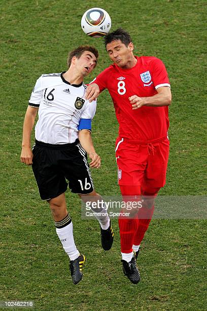 Philipp Lahm of Germany and Frank Lampard of England jump for the ball during the 2010 FIFA World Cup South Africa Round of Sixteen match between...
