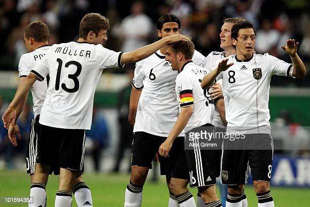 Philipp Lahm of Germany celebrates after scoring his team's first goal with team mates Lukas Podolski Thomas Mueller Sami Khedira Bastian...