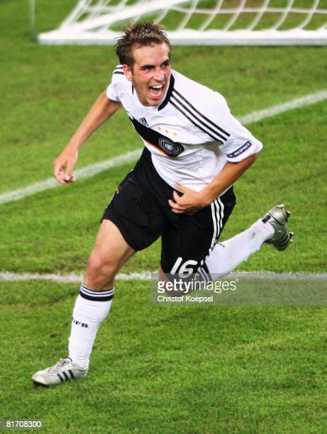 Philipp Lahm of Germany celebrates after scoring his team's third goal against Turkey during the UEFA EURO 2008 Semi Final match between Germany and...