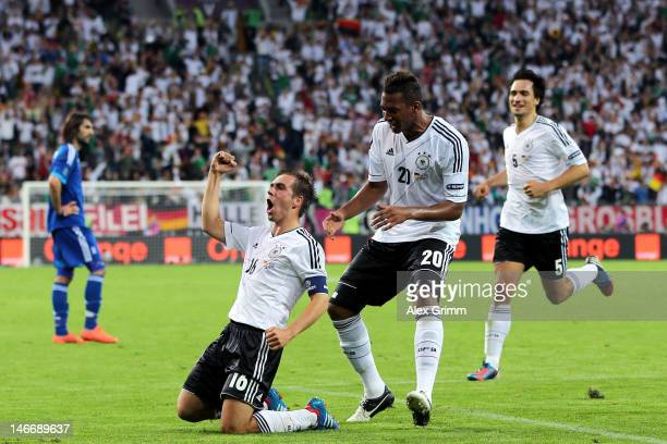 Philipp Lahm of Germany celebrates scoring their first goal with Jerome Boateng during the UEFA EURO 2012 quarter final match between Germany and...