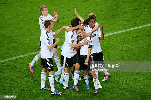 Philipp Lahm of Germany celebrates scoring their first goal with team mates during the UEFA EURO 2012 quarter final match between Germany and Greece...