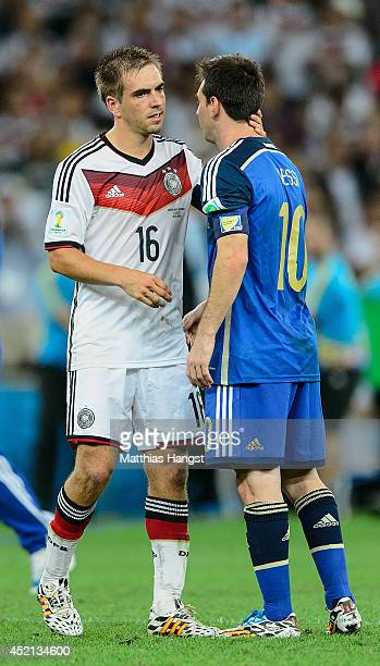 Philipp Lahm of Germany comforts Lionel Messi of Argentina after defeating Argentina 1-0 in extra time during the 2014 FIFA World Cup Brazil Final...