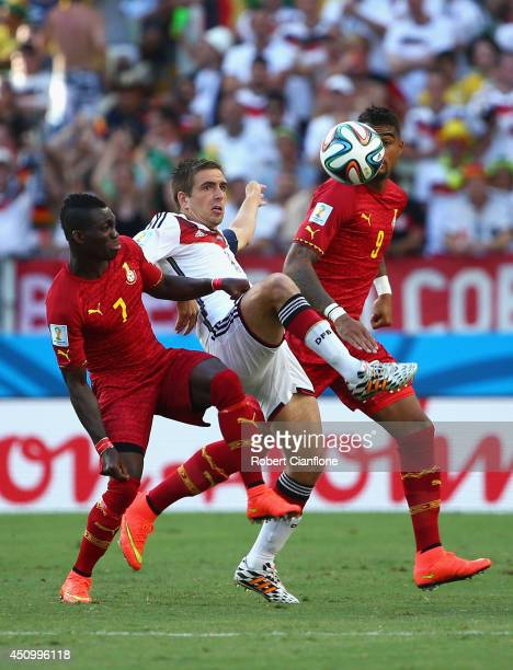 Philipp Lahm of Germany competes for the ball with Christian Atsu of Ghana during the 2014 FIFA World Cup Brazil Group G match between Germany and...