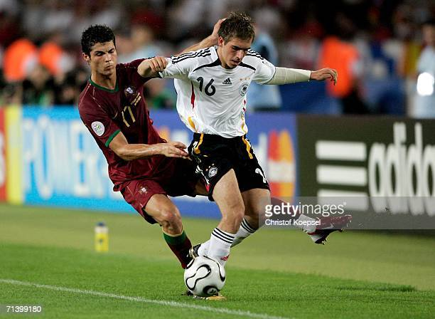 Philipp Lahm of Germany holds off the challenge of Cristiano Ronaldo of Portugal during the FIFA World Cup Germany 2006 Third Place Playoff match...