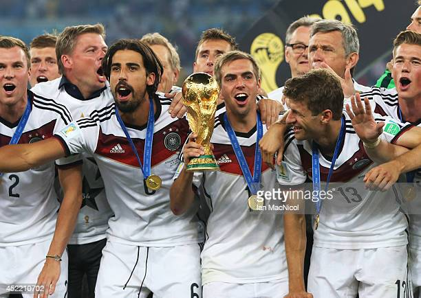 Philipp Lahm of Germany holds the trophy during the 2014 World Cup final match between Germany and Argentina at The Maracana Stadium on July 13 2014...