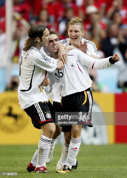 Philipp Lahm of Germany is congratulated by teammates Torsten Frings and Bastian Schweinsteiger after scoring the opening goal during the FIFA World...