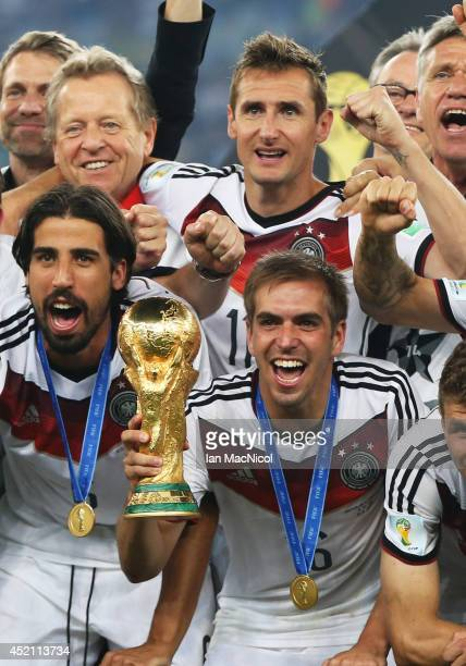 Philipp Lahm of Germany lifts the trophy during the 2014 World Cup final match between Germany and Argentina at The Maracana Stadium on July 13 2014...