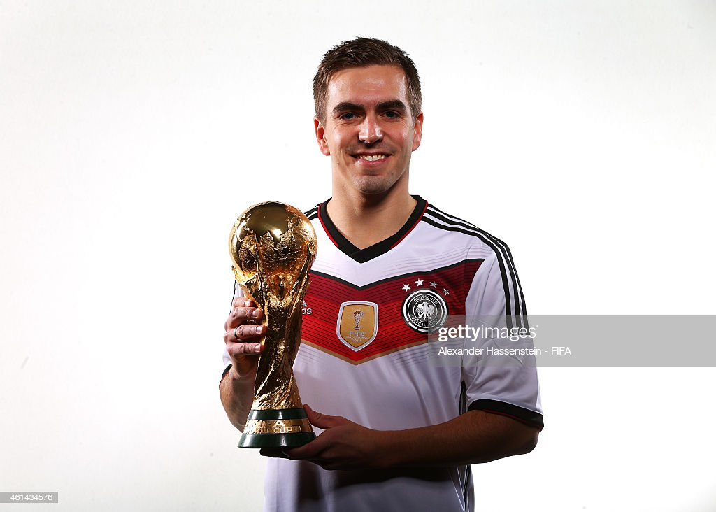 Philipp Lahm of Germany poses with the FIFA World Cup Trophy prior to the FIFA Ballon d'Or Gala 2014 at the Park Hyatt hotel on January 12, 2015 in Zurich, Switzerland.