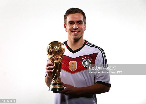 Philipp Lahm of Germany poses with the FIFA World Cup Trophy prior to the FIFA Ballon d'Or Gala 2014 at the Park Hyatt hotel on January 12 2015 in...