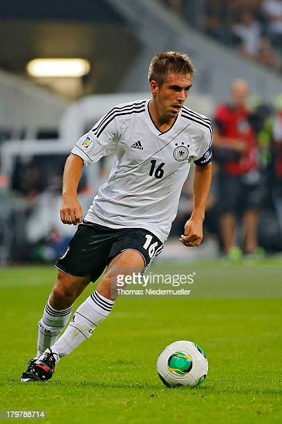 Philipp Lahm of Germany runs with the ball during the FIFA 2014 World Cup Qualifying Group C match between Germany and Austria at Allianz Arena on...
