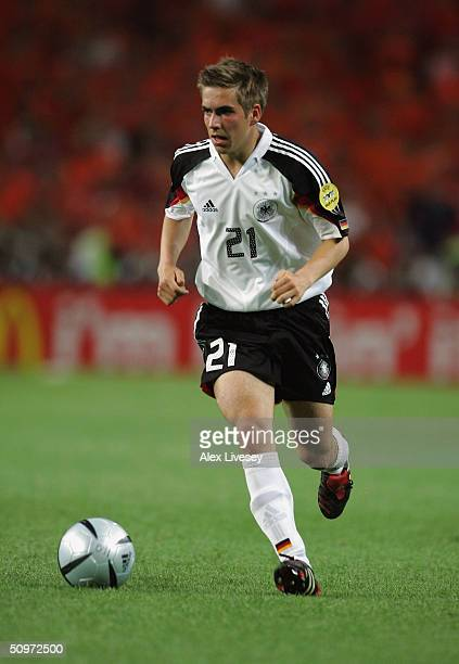 Philipp Lahm of Germany runs with the ball during the UEFA Euro 2004, Group D match between Germany and Holland at the Drago Stadium on June 15, 2004...