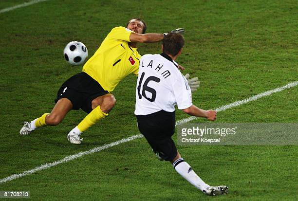 Philipp Lahm of Germany scores his team's third goal against Turkey during the UEFA EURO 2008 Semi Final match between Germany and Turkey at St...