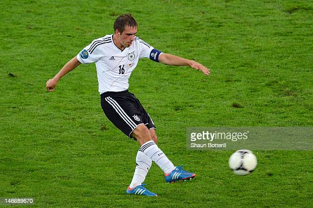 Philipp Lahm of Germany scores their first goal during the UEFA EURO 2012 quarter final match between Germany and Greece at The Municipal Stadium on...