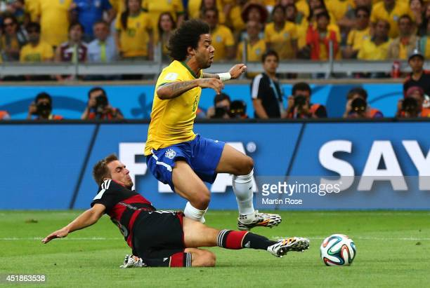 Philipp Lahm of Germany tackles Marcelo of Brazil during the 2014 FIFA World Cup Brazil Semi Final match between Brazil and Germany at Estadio...