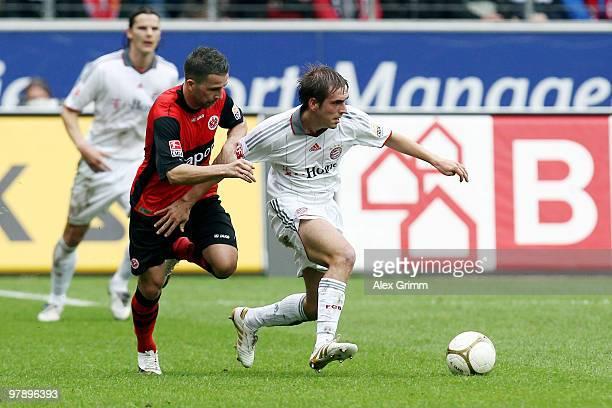 Philipp Lahm of Muenchen and Benjamin Koehler of Frankfurt battle for the ball during the Bundesliga match between Eintracht Frankfurt and Bayern...