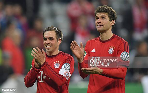 Philipp Lahm of Muenchen and Thomas Mueller of Muenchen react after the DFB Cup Semi Final match between FC Bayern Muenchen and Werder Bremen on...