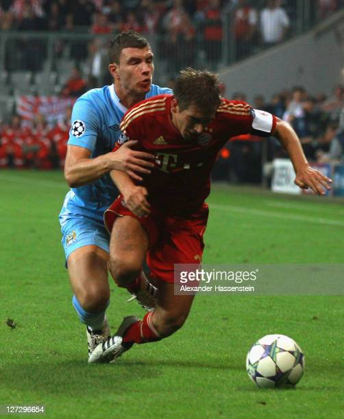 Philipp Lahm of Muenchen battles for the ball with Edin Dzeko of Manchester during the UEFA Champions League group A match between FC Bayern Muenchen...