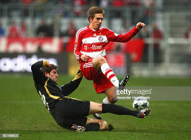 Philipp Lahm of Muenchen battles for the ball with Ivan Radeljic of Cottbus during the Bundesliga match between FC Bayern Muenchen and Energie...