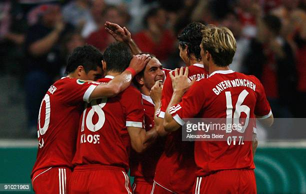Philipp Lahm of Muenchen celebrates his first goal with teammates Jose Ernesto Sosa Miroslav Klose Mario Gomez and Andreas Ottl during the DFB Cup...