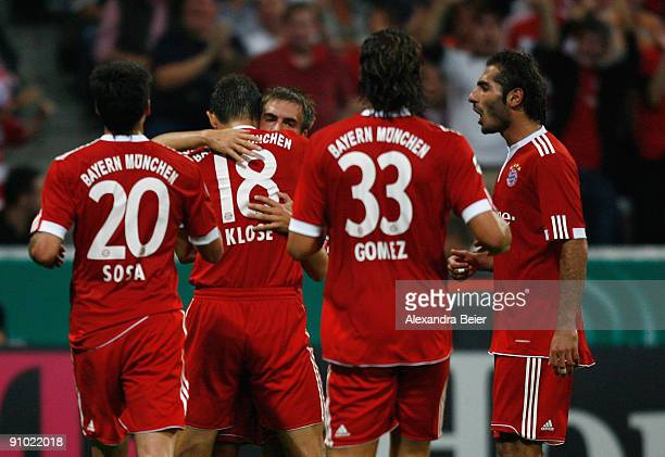 Philipp Lahm of Muenchen celebrates his first goal with teammates Jose Ernesto Sosa Miroslav Klose Mario Gomez and Hamit Altintop during the DFB Cup...