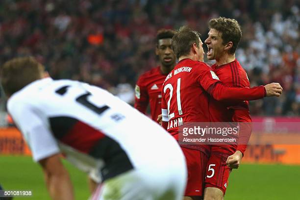 Philipp Lahm of Muenchen celebrates scoring the 2nd team goal with his team mate Thomas Mueller during the Bundesliga match between FC Bayern...