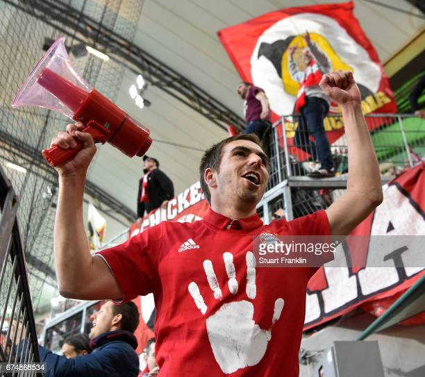 Philipp Lahm of Muenchen celebrates winning the Bundesliga title after the Bundesliga match between VfL Wolfsburg and Bayern Muenchen at Volkswagen...