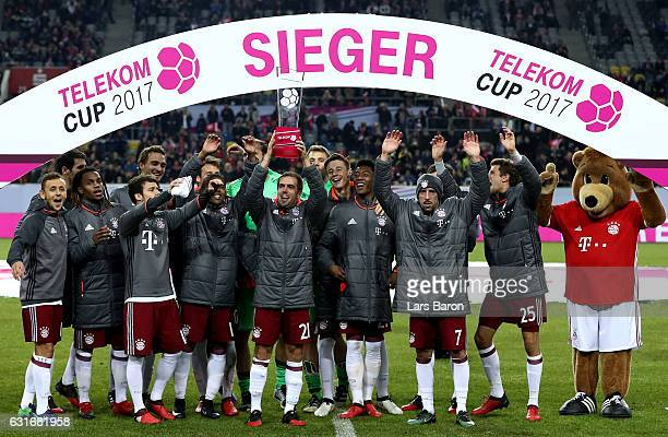 Philipp Lahm of Muenchen celebrates with the trophy after winning the Telekom Cup 2017 final between Bayern Muenchen and FSV Mainz 05 at EspritArena...