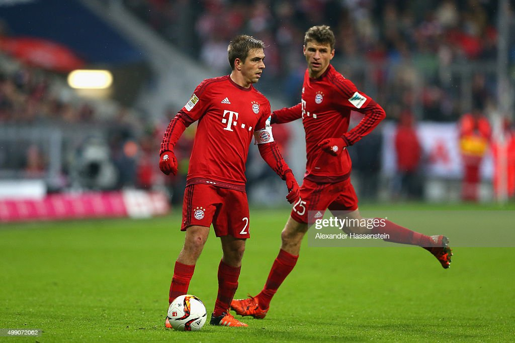 Philipp Lahm (L) of Muenchen controls with his team mate Thomas Mueller the ball during the Bundesliga match between FC Bayern Muenchen and Herha BSC Berlin at Allianz Arena on November 28, 2015 in Munich, Germany.