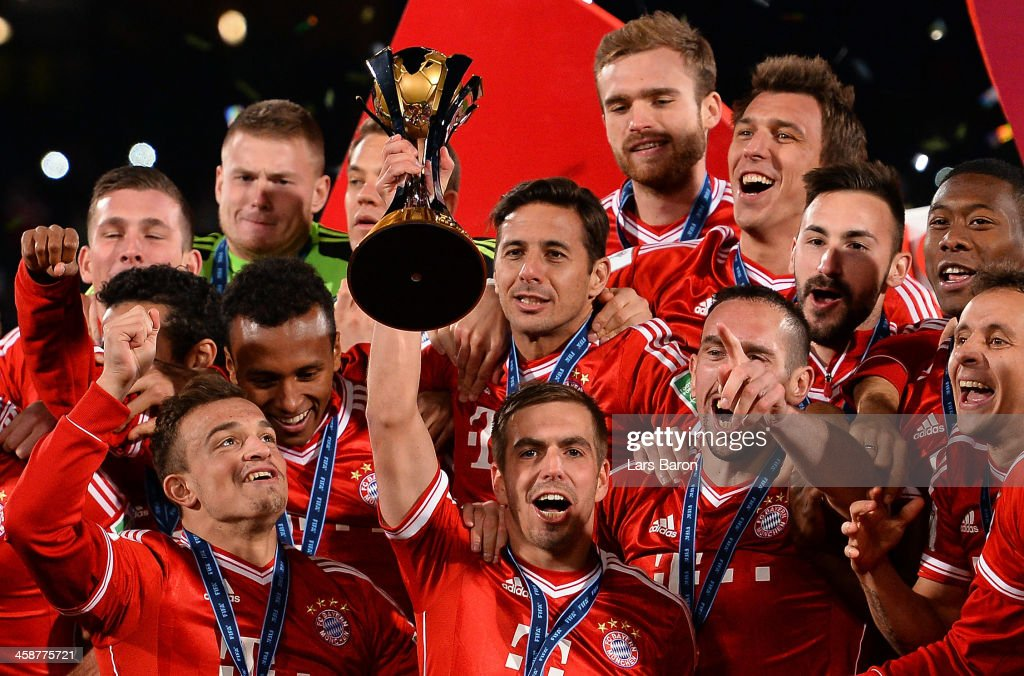 Philipp Lahm of Muenchen lifts the trophy after winning the FIFA Club World Cup Final between FC Bayern Muenchen and Raja Casablanca at Marrakech Stadium on December 21, 2013 in Marrakech, Morocco.