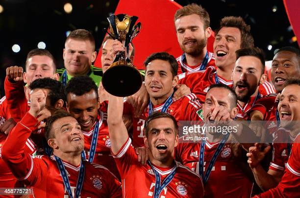 Philipp Lahm of Muenchen lifts the trophy after winning the FIFA Club World Cup Final between FC Bayern Muenchen and Raja Casablanca at Marrakech...