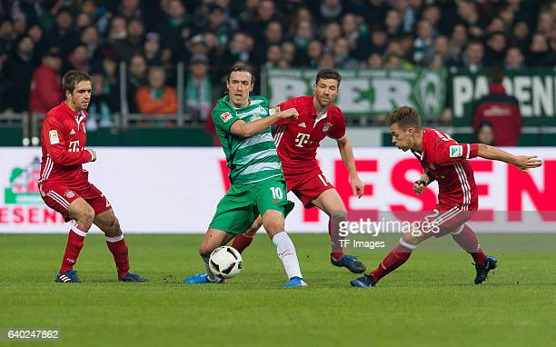 Philipp Lahm of Muenchen Max Kruse of Bremen Xabi Alonso of Muenchen and Joshua Kimmich of Muenchen battle for the ball during the Bundesliga match...