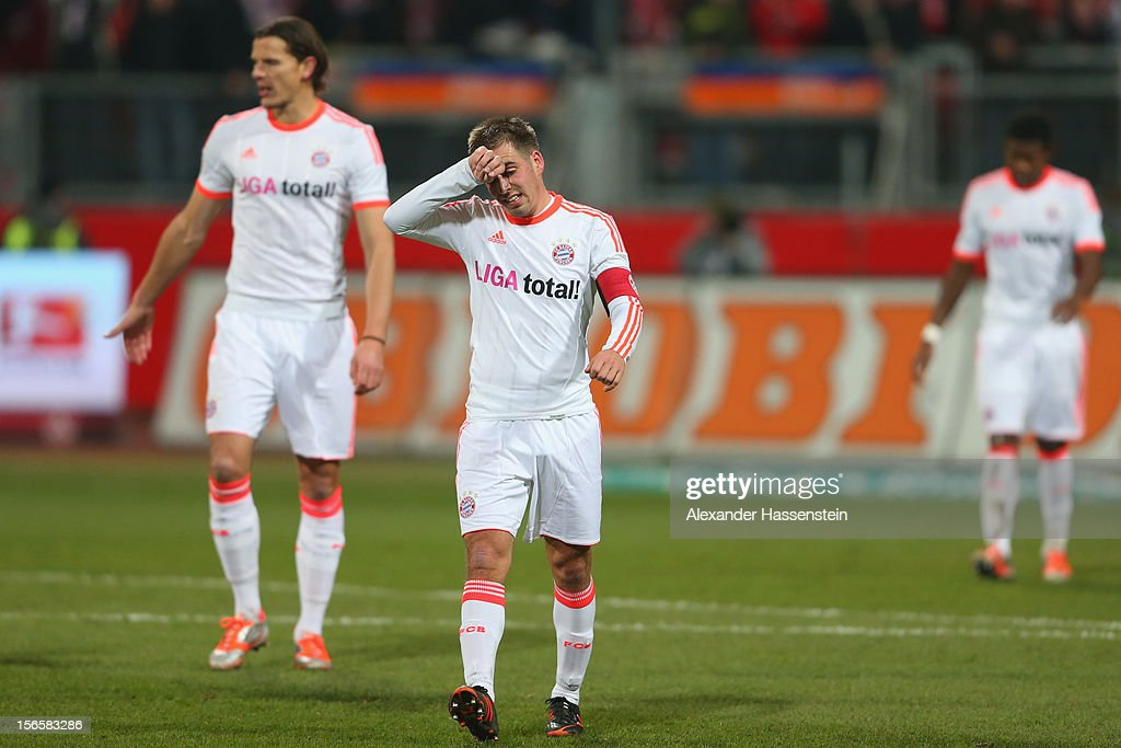 Philipp Lahm (C) of Muenchen reacts with his team mates Dante ( L) and David Alaba (R) after the Bundesliga match between 1. FC Nuernberg and FC Bayern Muenchen at Easy Credit Stadium on November 17, 2012 in Nuremberg, Germany.