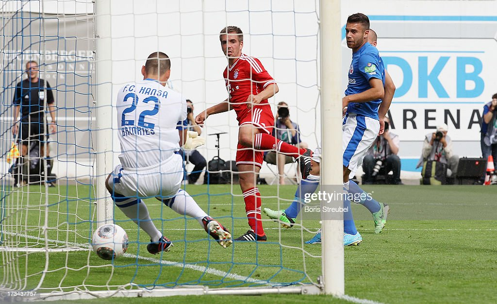 Philipp Lahm (C) of Muenchen scores his team's first goal during the charity match between Hansa Rostock and FC Bayern Muenchen at DKB-Arena on July 14, 2013 in Rostock, Germany.
