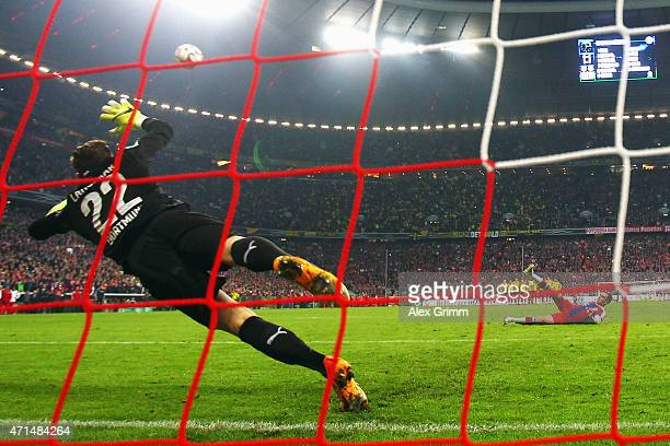 Philipp Lahm of Muenchen slips during the penalty shootout during the DFB Cup Semi Final match between FC Bayern Muenchen and Borussia Dortmund at...