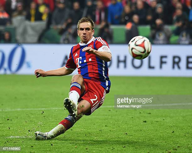 Philipp Lahm of Muenchen slips over during the penalty shoot out during the DFB Cup semi final match between FC Bayern Muenchen and Borussia Dortmund...