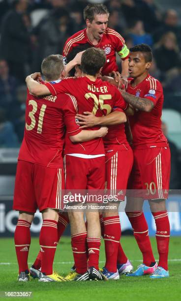 Philipp Lahm of Munich celebrates the second team goal with his team mates during the UEFA Champions League quarterfinal second leg match between...