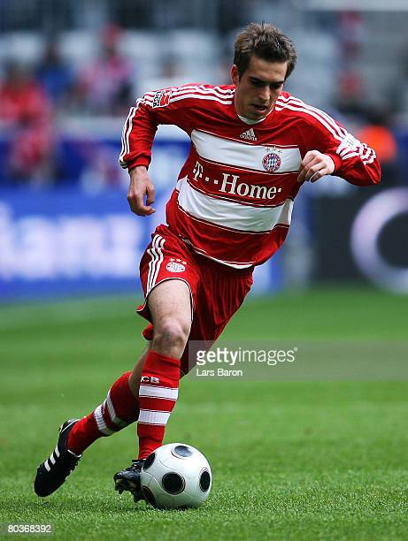 Philipp Lahm of Munich runs with the ball during the Bundesliga match between Bayern Munich and Bayer Leverkusen at the Allianz Arena on March 22...