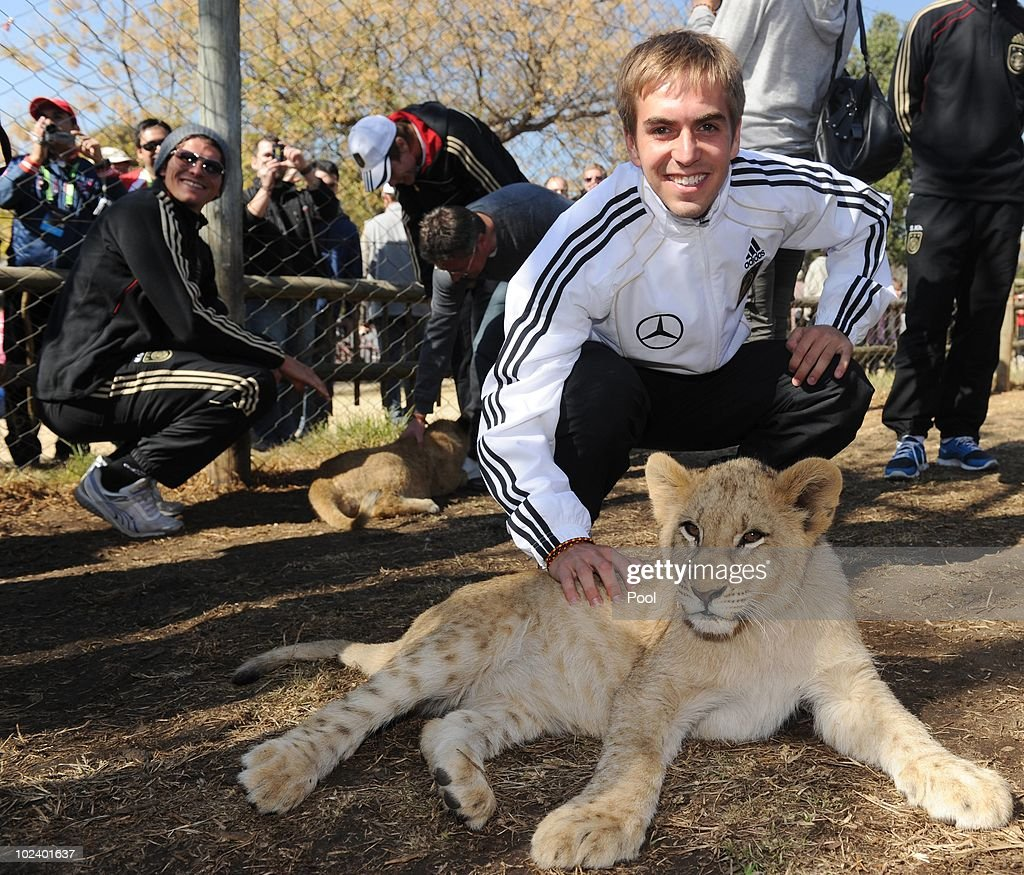 Philipp Lahm of the German National Team strokes a lion cup during a visit at the Lion Park on June 25, 2010 in Lanseria, South Africa.