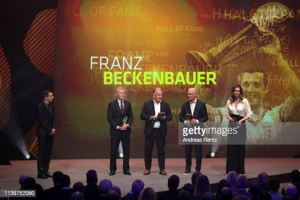 Philipp Lahm Paul Breitner Andreas Brehme and Franz Beckenbauer are seen on stage the Hall Of Fame gala at Deutsches Fussballmuseum on April 01 2019...