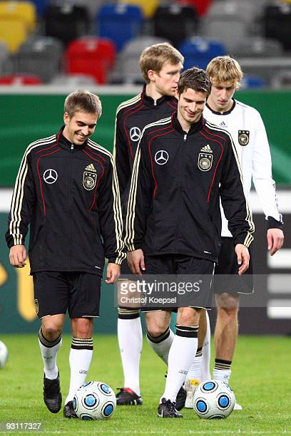 Philipp Lahm Per Mertesacker Arne Friedrich and Stefan Kiessling are seen during a German National team training session at the Esprit Arena on...