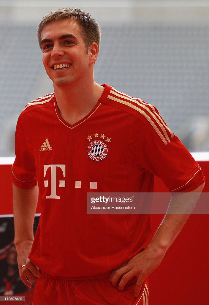 Philipp Lahm poses in the new FC Bayern Muenchen home jersey for the season 2011/12 at Allianz Arena on April 19, 2011 in Munich, Germany.