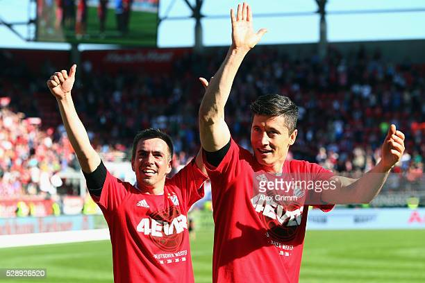 Philipp Lahm Robert Lewandowski and team mates of Muenchen celebrate being Bundesliga champions after beating Ingolstadt 21 in Rafinha and team mates...