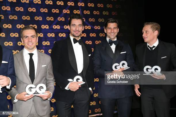 Philipp Lahm Soccerplayer FC Bayern Muenchen David Gandy Johannes Huebl and Matthias Schweighoefer with award during the show of the GQ Men of the...
