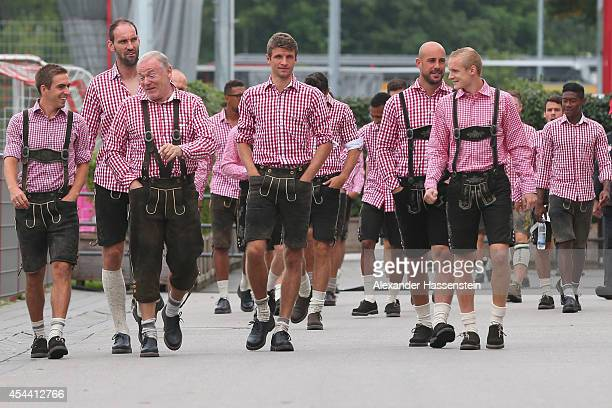 Philipp Lahm team captain of Bayern Muenchen arrives with his team Tom Starke assistent coach Hermann Gerland Thomas Mueller Pepe Reina and Sebastian...