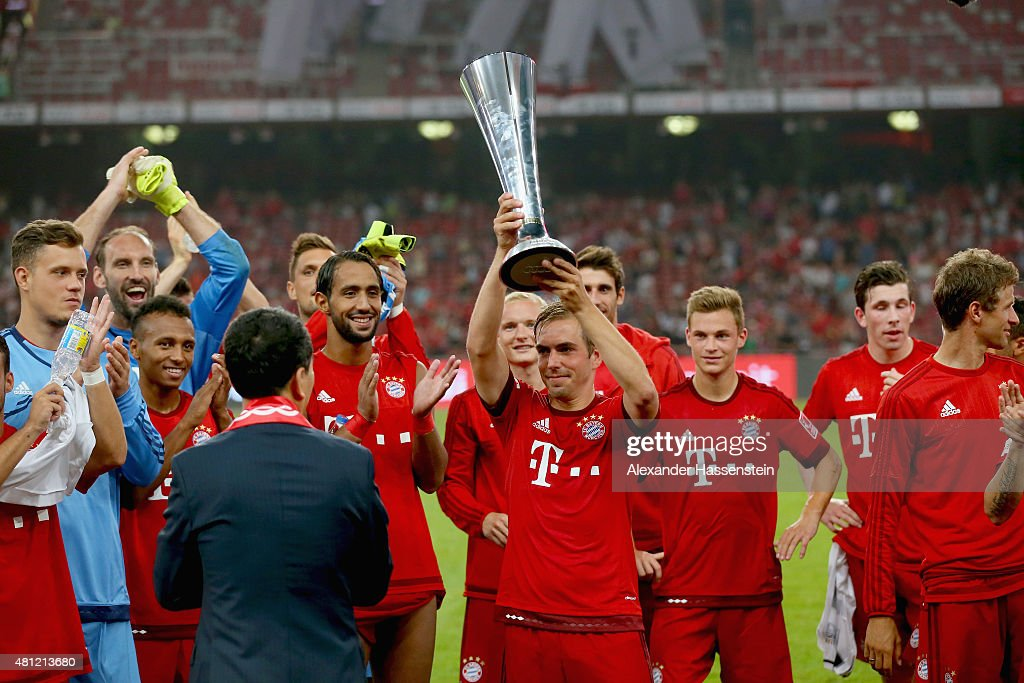 Philipp Lahm, team captain of FC Bayern Muenchen lifts up the Audi Football Summit 2015 winners trophy after winning the international friendly match between FC Bayern Muenchen and Valencia FC during the Audi Football Summit 2015 at National Stadium on July 18, 2015 in Beijing, China.